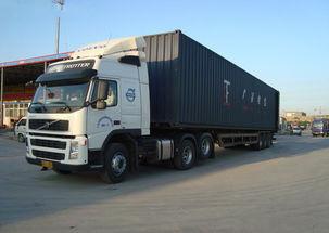 話多無益把貨物運到港口裝箱青島集裝箱車隊數量